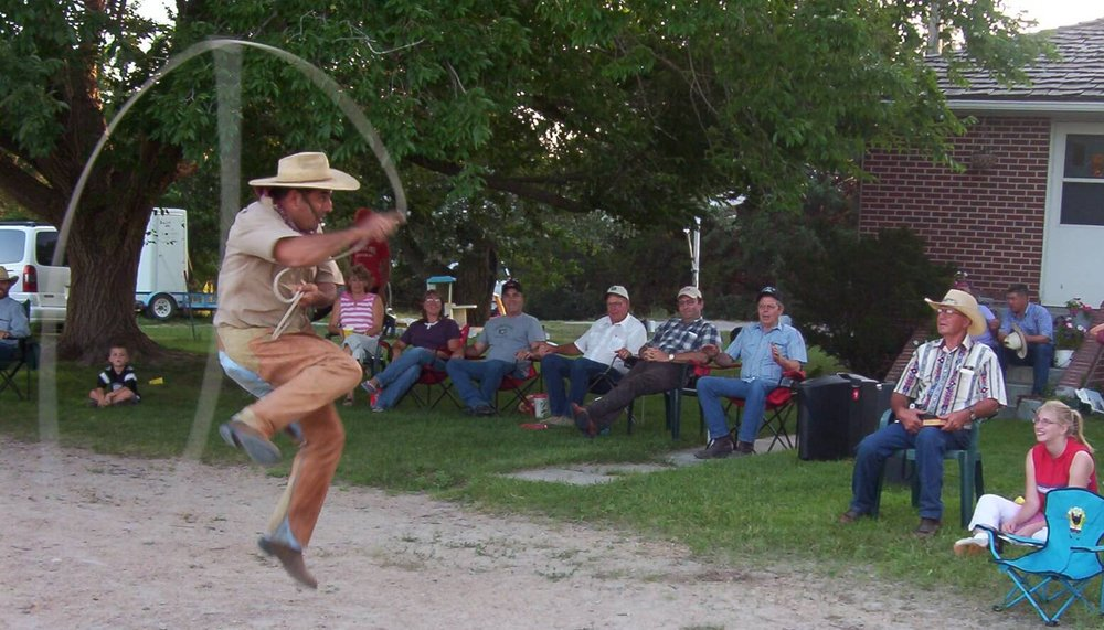 Oscar showing his stuff at a ranch with a group of new friends from Nebraska.