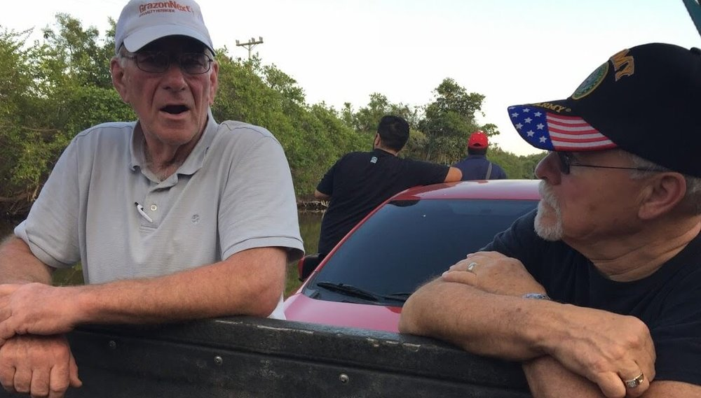 Rex Kelly, left, and Ray Gurney share a moment to reflect on a car ferry near Monterrrico, Guatemala.