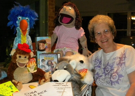Here Betty poses with some puppets she made just before she sent them to Cuba.