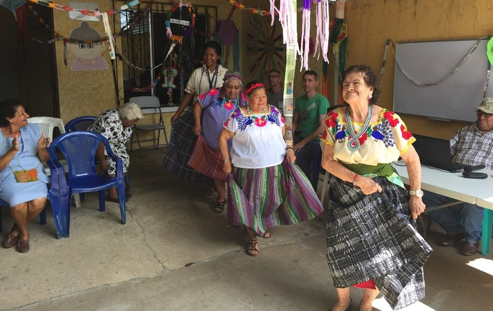 Ladies at the senior citizens center in Santa Cruz Narranjo perform Guatemala's official dance.