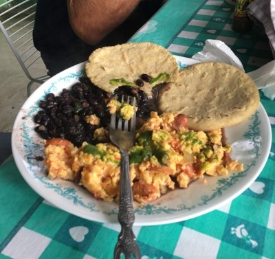 Here are the staples of the Guatemala diet—beans, eggs, and tortillas. The eggs can be fixed almost any way you like, and this meal can be eaten for breakfast, lunch, or dinner. Here, Ty was loading up on the green hot sauce!
