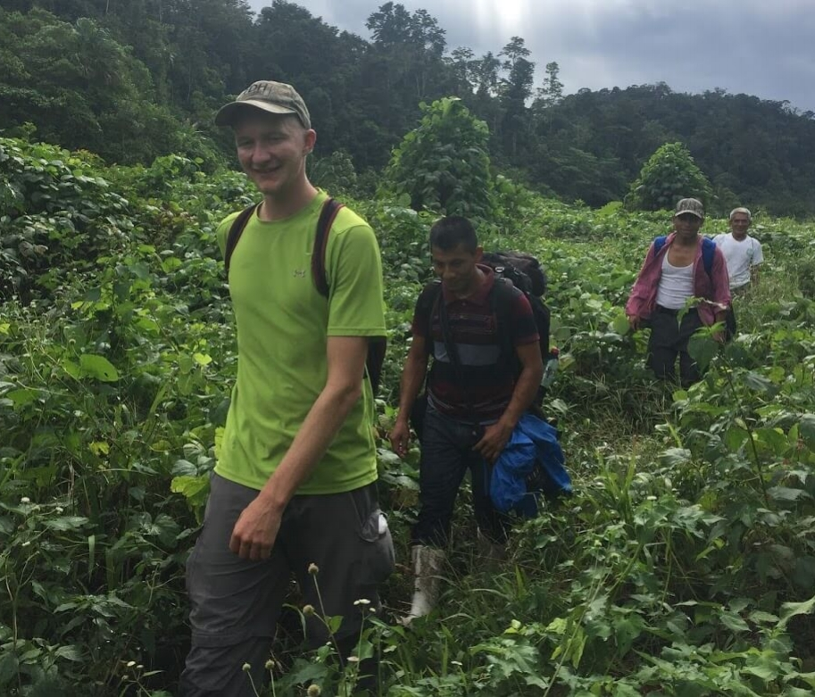 "On one of the lower flat sections of the trail, I was grateful that this was the ""dry"" season, and we had virtually no mud to slop through. Behind Aden is Cesario, Lorenzo (pastor of the church at Ochul Choch), and Pedro."