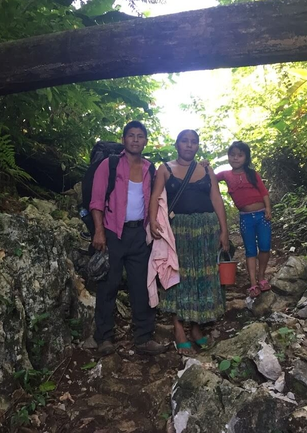 After spending the night hanging in a couple of hammocks in the church, Lorenzo and his wife and daughter show us where they are working their fields.