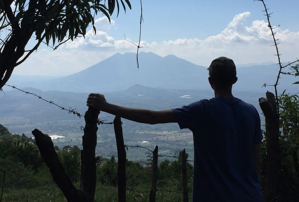 Coming out of the jungle, Aden reflects on his week in Guatemala, and he admires one of Guatemala's several mountain ranges of volcanoes. This one is near Ipala, Guatemala.
