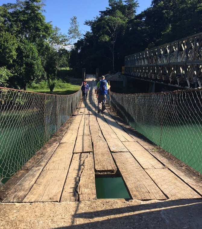 This swinging bridge that has handled foot traffic for many years may become obsolete in the near future. Watch out for that first step! It's a doozy!