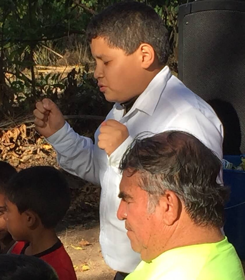 "Sanders, a 12 year old boy, prays at the end of our meeting in Las Bolsitas. Called ""the preacher,"" Sanders has been a believer for a couple of years and owes his dedication to God delivering him his life when he had no hope for living through a serious illness."