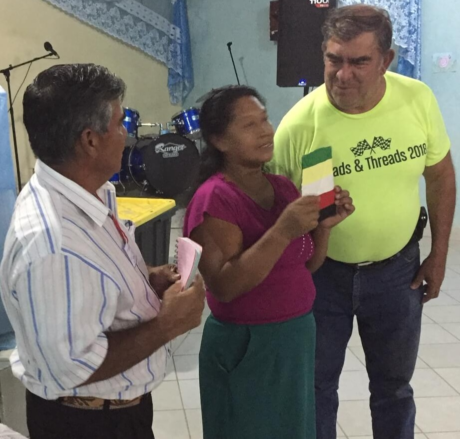At the end of the children´s meeting, Cesar presented colored pot holders to some of the women and asked this volunteer to share what the colors mean.