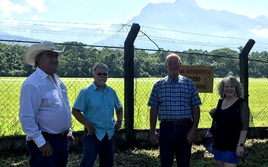 Standing at the back of the property of the Cattlemen's Association in La Ceiba, Honduras, you can see the runway in the background for their international airport. Standing left to right is Cesar Gonzalez, Ray Gurney, Rex Kelley, and my wife Nola. Rex couldn't help but be excited about the possibility of one day flying his airplane here! Please pray with him on that.