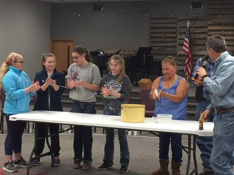"Elba showed some girls at the AWANA ""Taste of Guatemala"" night in Burwell, Nebraska, how to make tortillas."