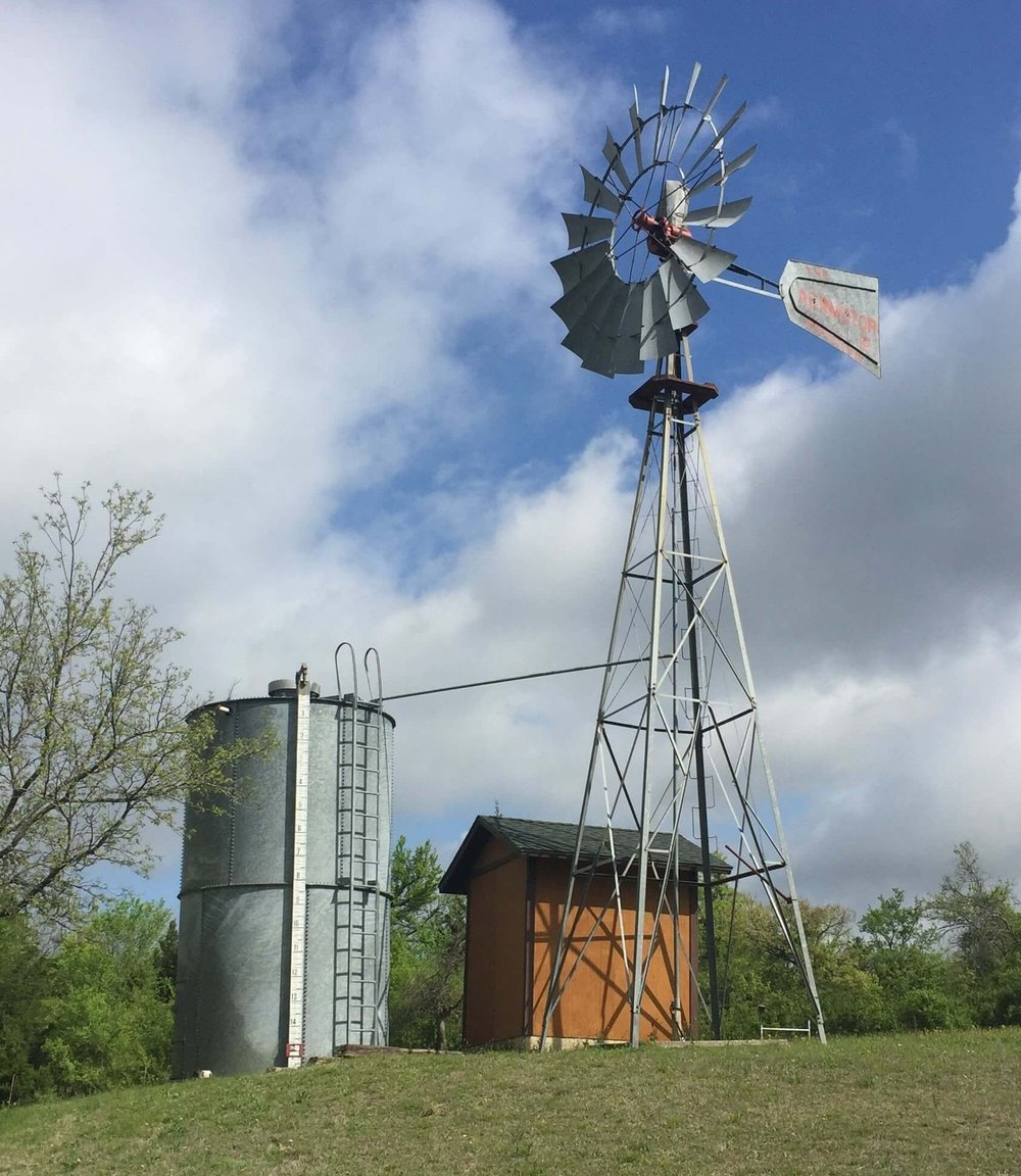 Near Benbrook, Texas, we visited Mark Welch's farm where he builds working windmills. This particular windmill provides all the water for his house.