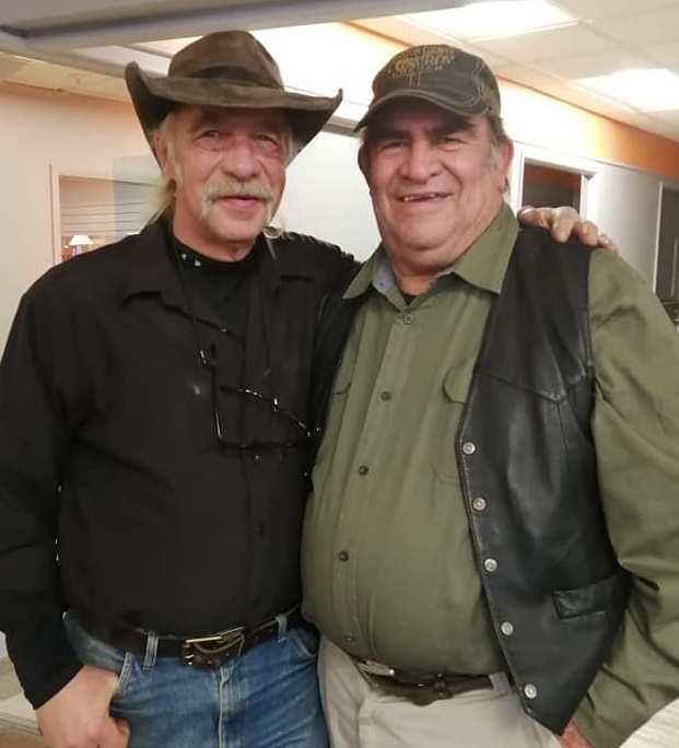 Cesar and Michael Wright, of Oak Grove, Missouri, pause for a picture between stories of surviving in the wilds of Alaska and Cesar sharing how he grew up in Guatemala.