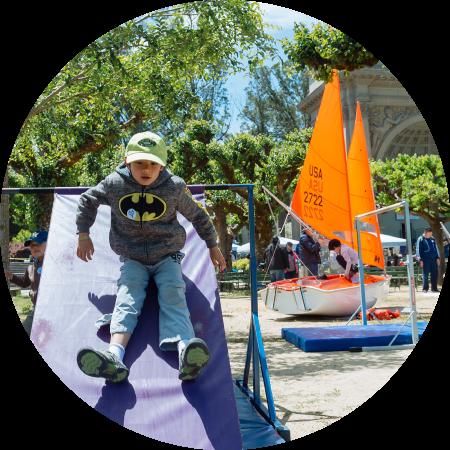 Boy sliding down slide. Link to Special Events