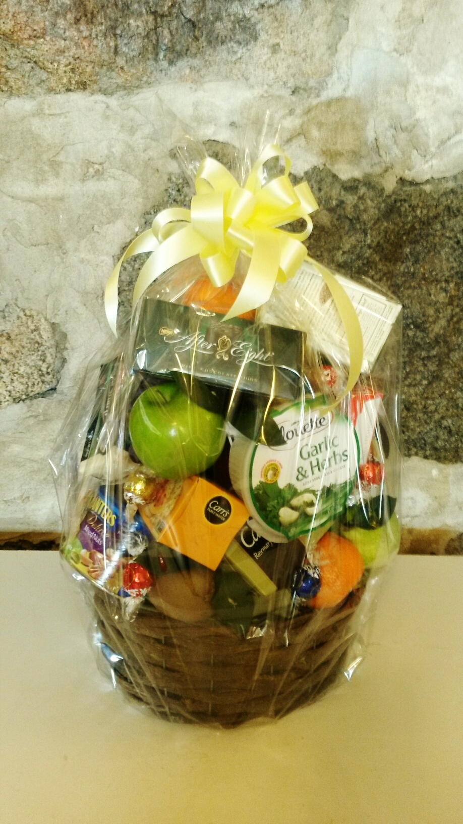 E14   $100 - $175 gourmet basket with fruit, cheese, nuts, crackers, sweets. $100 as shown.