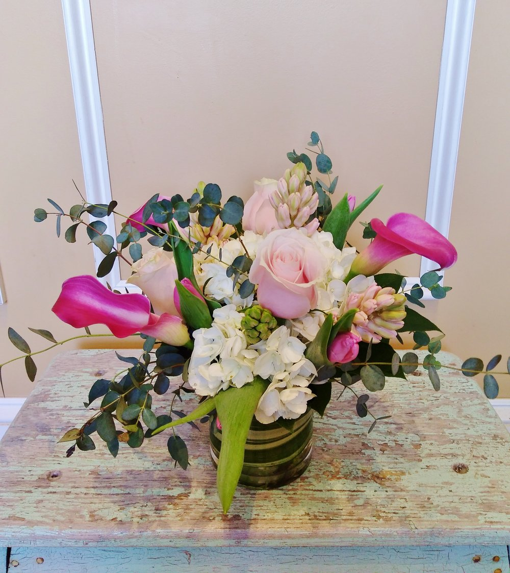 A12   $60 - $85 Cluster-style arrangements. $65 as shown.