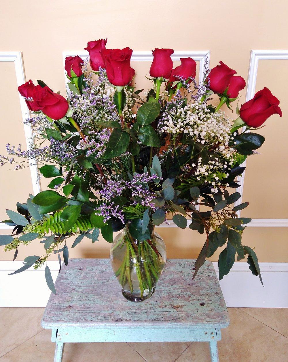 E9   $100 - $200 Tall contemporary arrangement. $125 as shown.