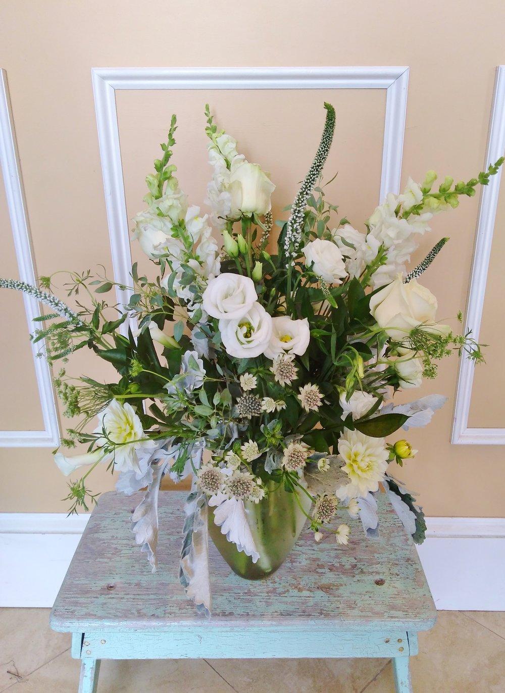 A9 $85-$150 Medium-tall classical style vase arrangement. $100 as shown.