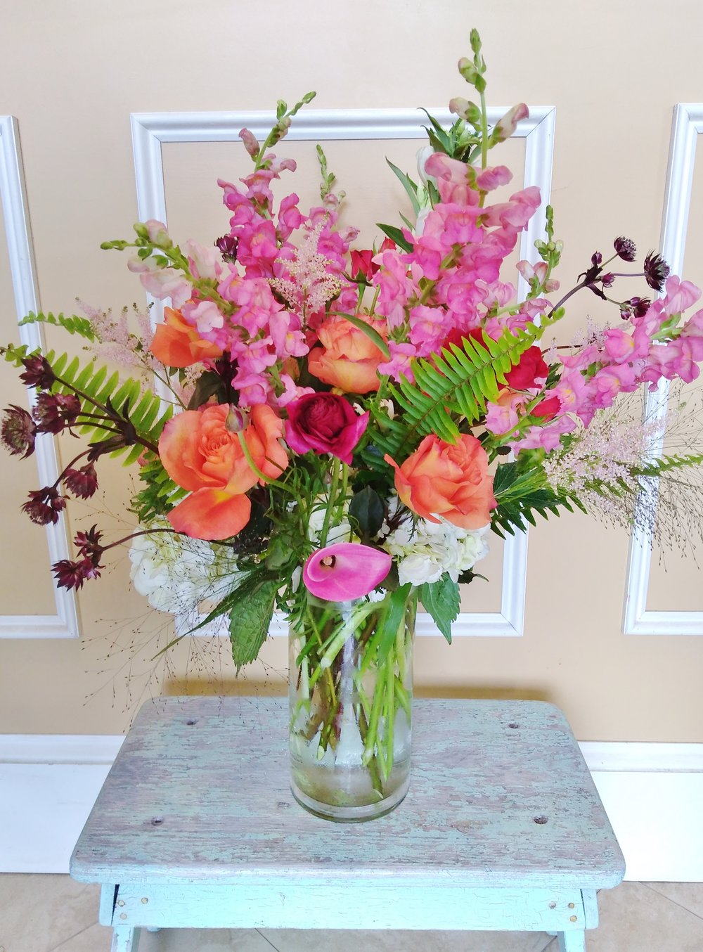 A10 $125-$200 Tall classical style vase arrangement. $175 as shown.