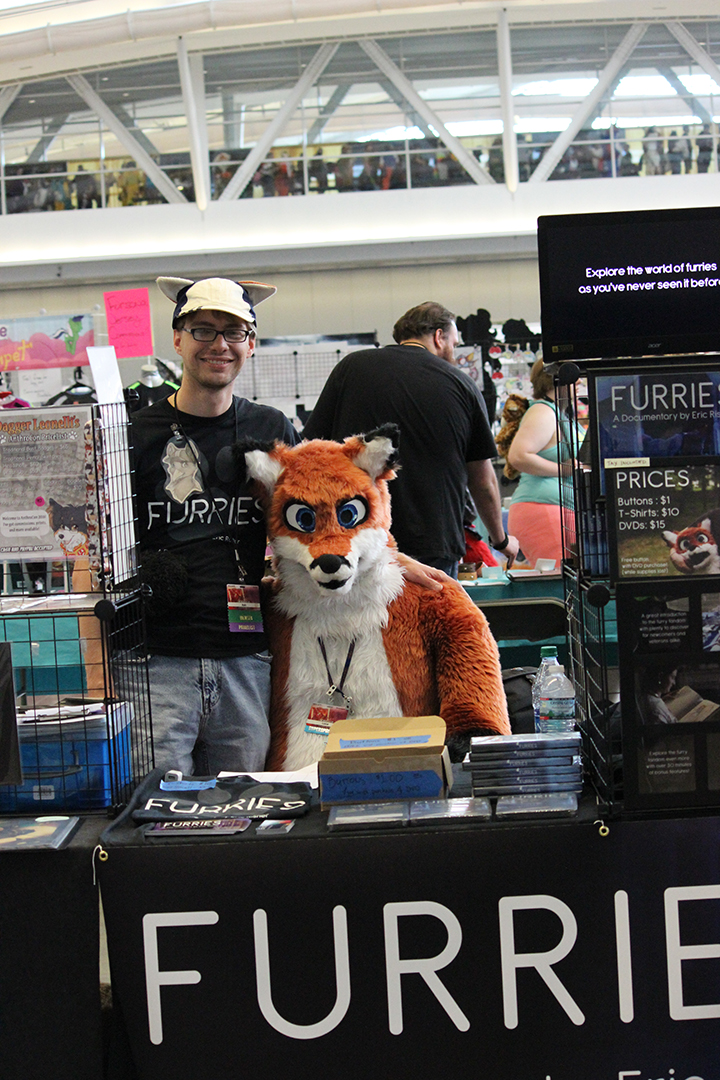 Director Eric Risher poses with Luca from the film at Anthrocon in Pittsburgh
