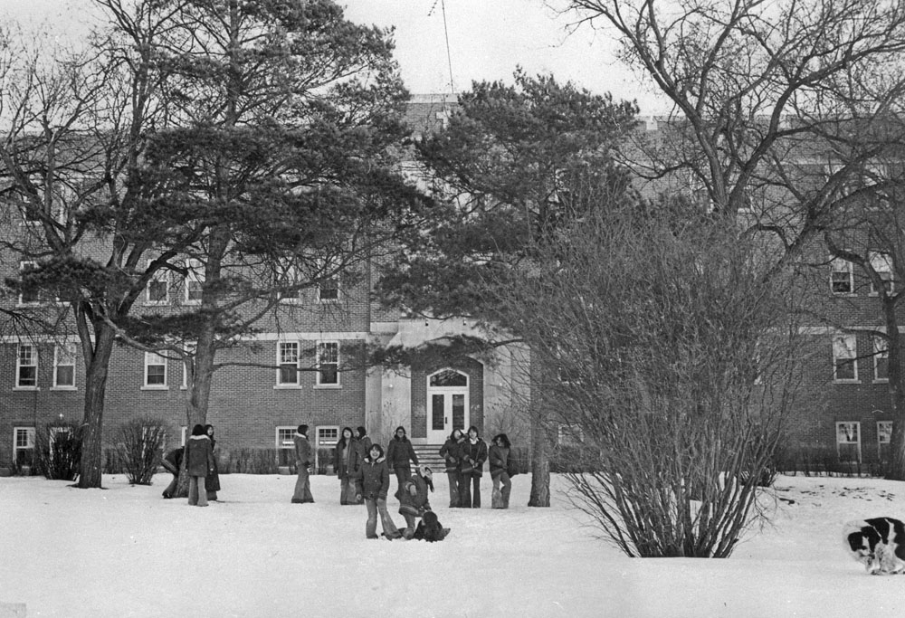 A07:   Fort Qu'Appelle Indian Residential School, group of students in front of the school, Lebret, March 1973