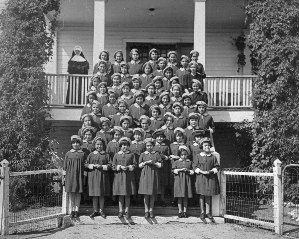 A08:   St. Anthony's Indian Residential School, female students and a nun, Onion Lake, ca. 1950