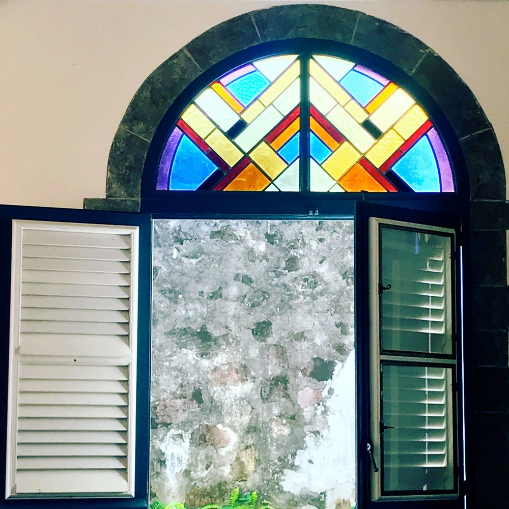 Church window, stone wall, stained glass, shutters