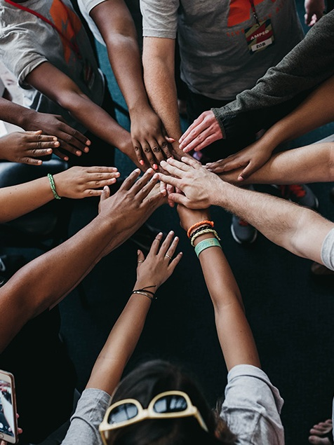 """Better Together  ,  Camylla Battani, 2018  """"This was our team huddle at church before VBS 2018. I believe that we can make a bigger difference in our community when we all work together despite our differences. I loved seeing all the skin tones represented in one photo and I thought that was the perfect picture of what Macon is like."""" -C.B."""