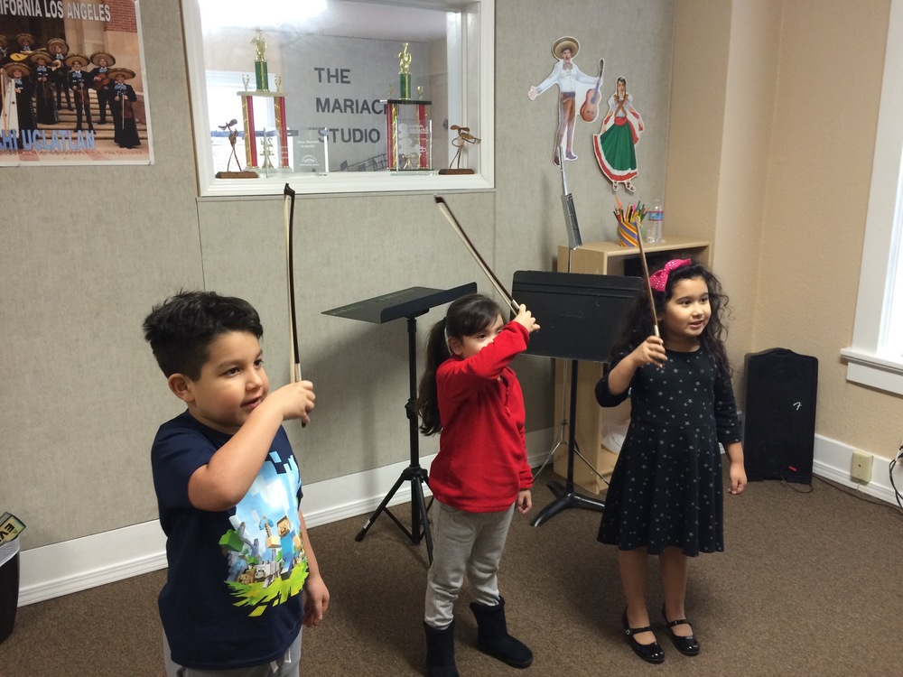 Students of The Mariachi Studio learning the rudiments of a good bow hold.