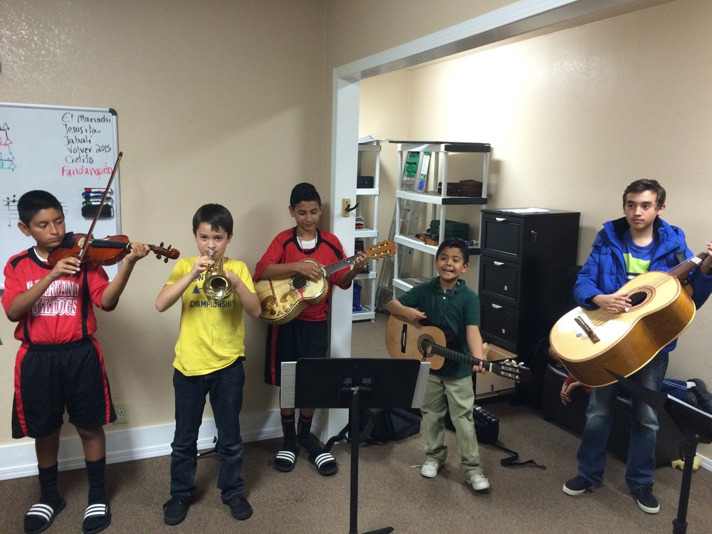 Students at a tier-one rehearsal at The Mariachi Studio