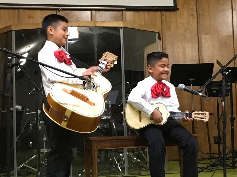 Tier One students performing guitarrón and vihuela scales in a recital.
