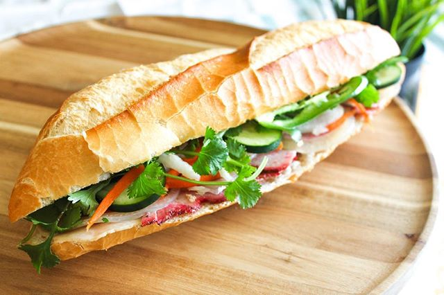 This is our Saigon Special (Bánh Mì Thịt Nguội) on a baguette. 🥖 All of our bánh mì sandwiches are FULLY LOADED with: your choice of bread, your choice of protein, loaded fillings (cucumber, cilantro, pickled daikon and carrots), jalapeños, and our creamy in-house house pâté + aioli.