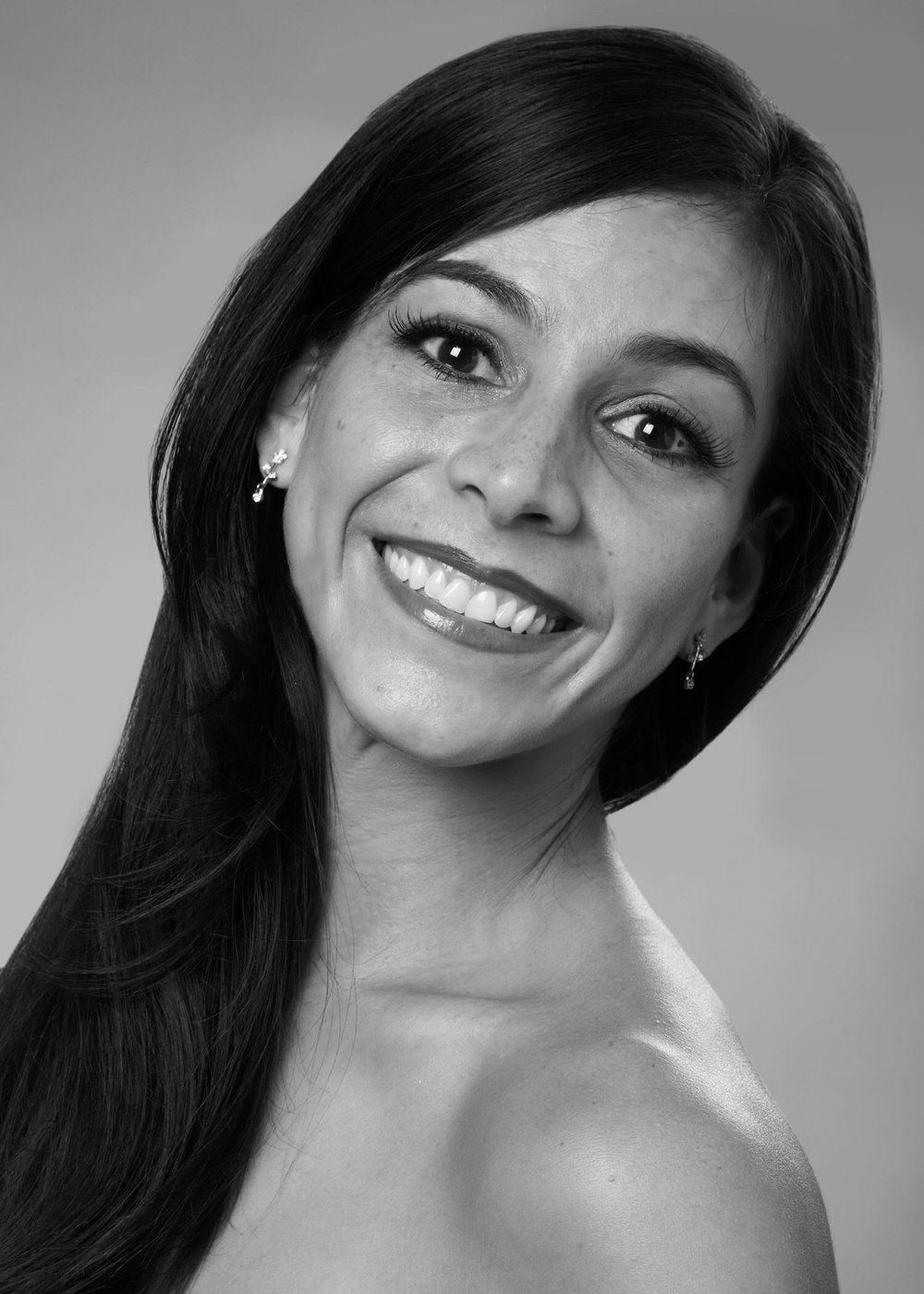 Yumelia Garcia - After retiring from Joffrey Ballet in 2014 Yumelia Garcia has not let the grass grow under her feet. While she is currently pursuing a bachelor's degree in Communication at the University of Wisconsin-Milwaukee, she also continues to make guest performances around the country from Florida to Alaska. In 2015 Gordon Pierce Schmidt created the ballet Day of the Gypsy on Ms. Garcia. It was performed at the Harris Theater in Chicago, and was among the Chicago Tribune's best performances in 2015. She has been the guest principal dancer for the Jacksonville Symphony in Sleeping Beauty, Nutcracker and is slated to perform Cinderella next April. She has recently worked in New York with the Kathryn Posin Dance Company collaborating with Meredith Monk in a commissioned ballet for the Harkness Dance Festival in Manhattan. She also is part of Joffrey Ballet's teaching workshop in San Antonio, TX and teaches and coaches for a number of schools from Buffalo, NY to Los Angeles, CA.Ms. Garcia was born in Caracas, Venezuela, where she received her professional training at the Escuela de Ballet Gustavo Franklin (Vaganova school). Upon graduating with honors, Vicente Nebrada invited her to join the National Ballet of Caracas at the tender age of 15, and promoted her to soloist one year later. Ms. Garcia began her U.S. career with Heinz Pohl at Ohio Ballet. She then joined the Milwaukee Ballet, performing as a principal dancer. While in Milwaukee, in addition to having Kathryn Posin's Scheherazade created for her, Ms. Garcia performed many classical roles, including Kitri in Don Quijote, Giselle, Juliet in Romeo and Juliet, Aurora in Sleeping Beauty, and Carmen. She later moved on to Ballet Florida, where she was featured in contemporary and classical works, most recently as Cleopatra, by Ben Stevenson. In 2009, Ms. Garcia was invited by Ashley Wheater to join the Joffrey Ballet of Chicago, where she hit the stage to critical acclaim in roles such as Valencienne in The 