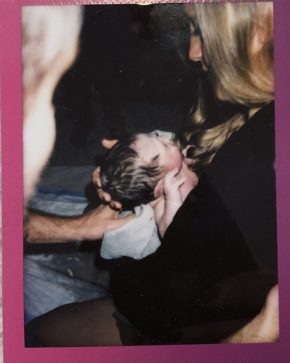 Aiden's polaroid shot from the birth that he was taking in the photo from above!