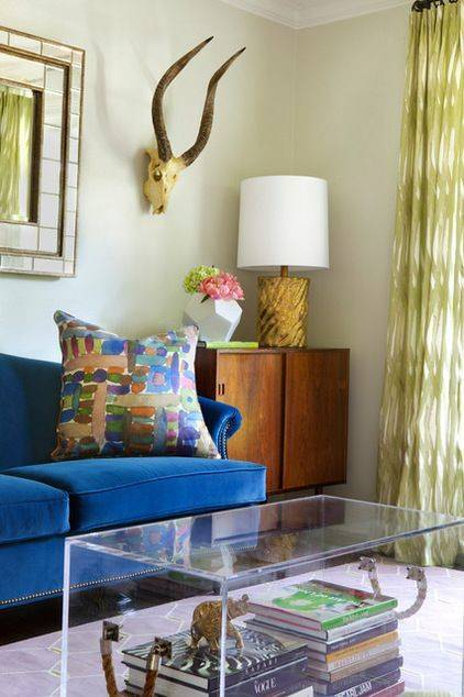 10-unexpected-ways-to-decorate-with-lucite-lucite-coffee-table-56cdefaccc657e184583dc1b-w620_h800.jpg