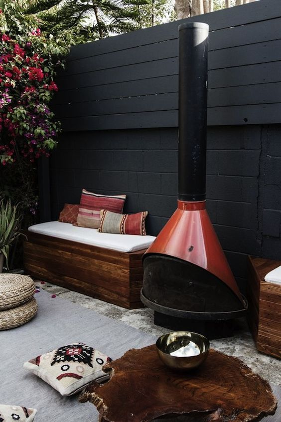 Black Wall Patio with Fireplace