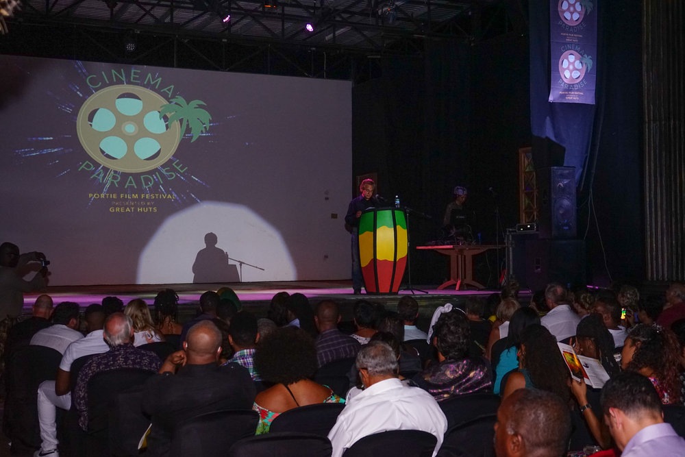 Great Huts founder, Dr Paul Rhodes 'aka Dr Paul,' addressing a crowd of 200+ for the VIP launch of 2017 Cinema Paradise at the Hope Zoo in Kingston Jamaica.