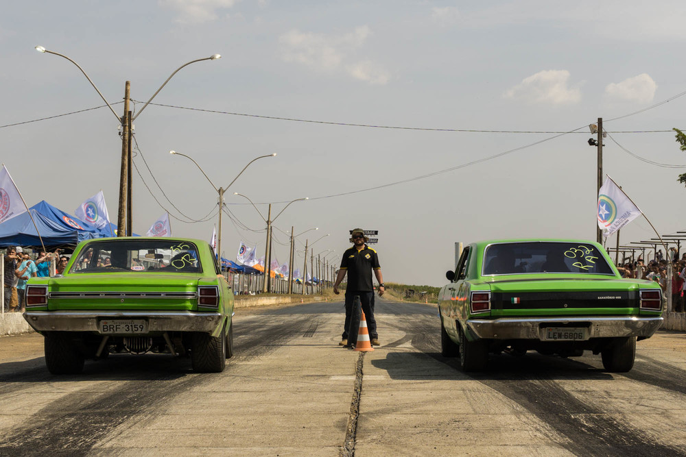 Two Cars waiting to start a Drag Race