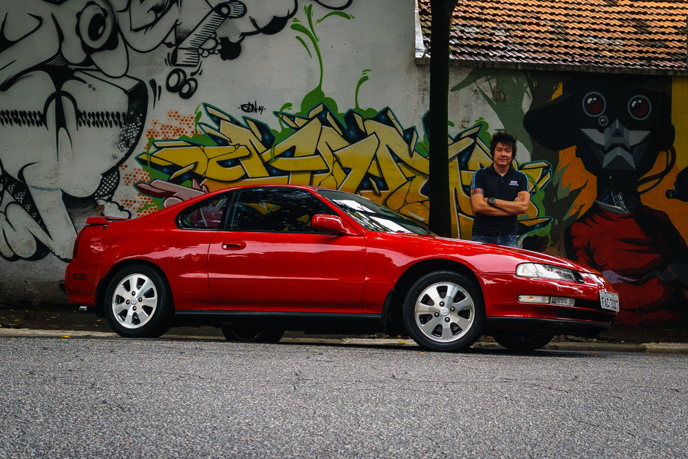 Juliano standing behind his Prelude