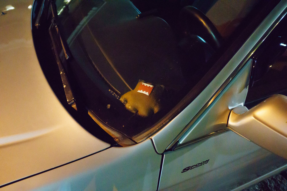 Stuffed Domo Doll under windshield