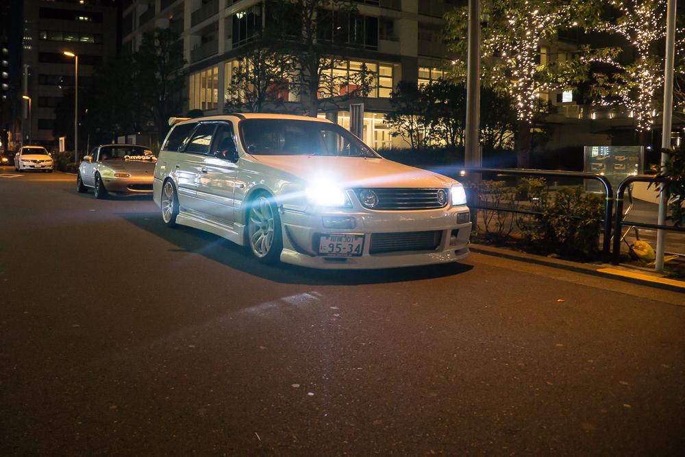 Car parked outside Akhibara DX Parking Garage