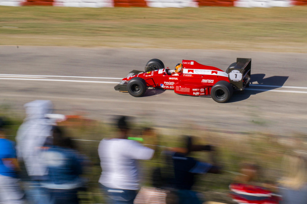 Formula 1 Car racing up a hill