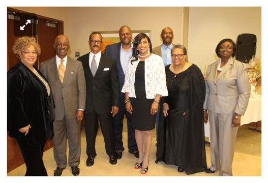 Founder Crystal and Gary Carpenter, center, and the board of directors