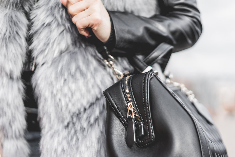 woman-holding-her-black-leather-bag-close-up-picjumbo-com.jpg