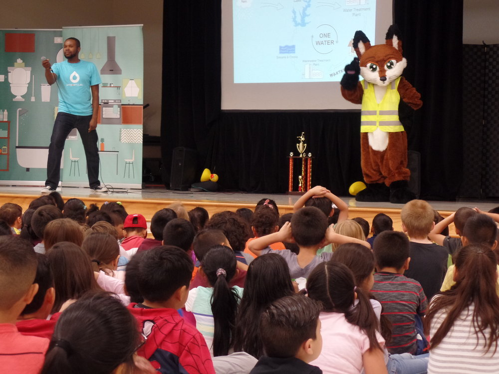 Our Emcee and Farah onstage in Plano, Texas
