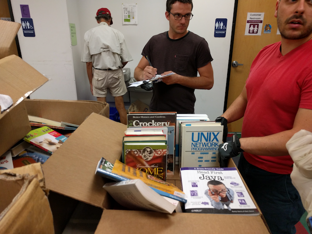 Contextual inquiry - We met staff and volunteers at Recycled Reads and watched them as they worked. We followed librarians in their branches and saw the process of sorting books firsthand.[Left] I listen and take notes on book sorting procedures