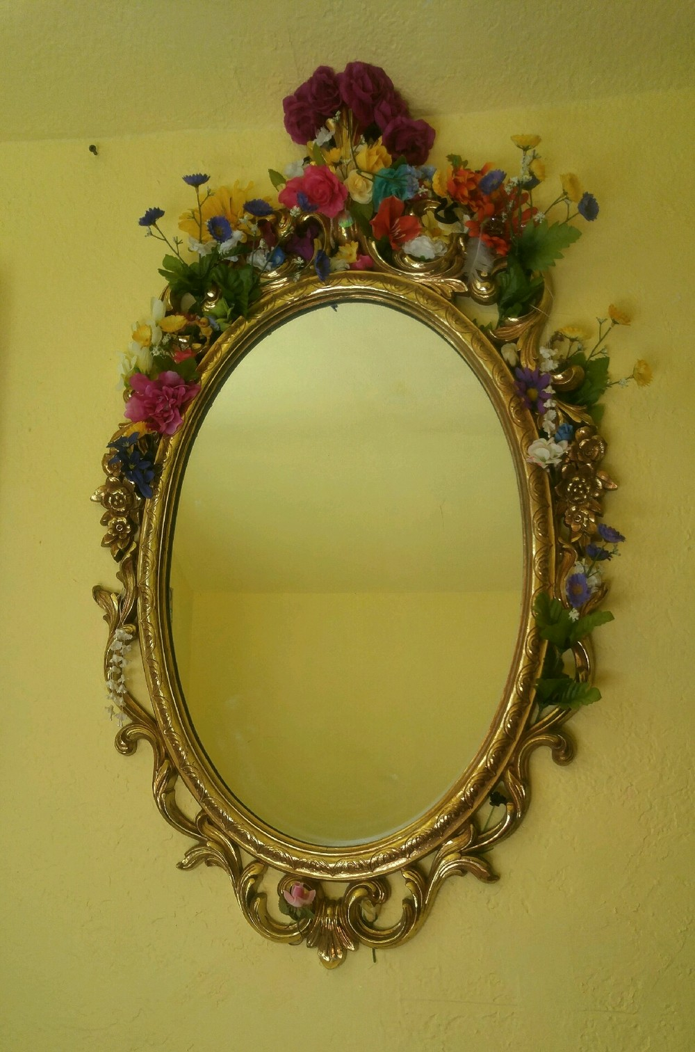 Beautiful vintage mirror + fake flowers = AWESOME!