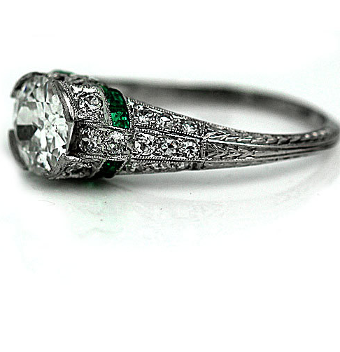From ArtDecoDiamonds on Etsy - $8,750 - from the 1920s Those emeralds just MAKE the ring! Yum!