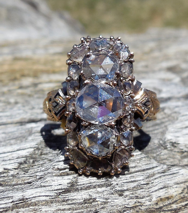 From  DiamondAddiction on Etsy - $3,850 - from the 1800s This one is stunning. And look at those rocks!