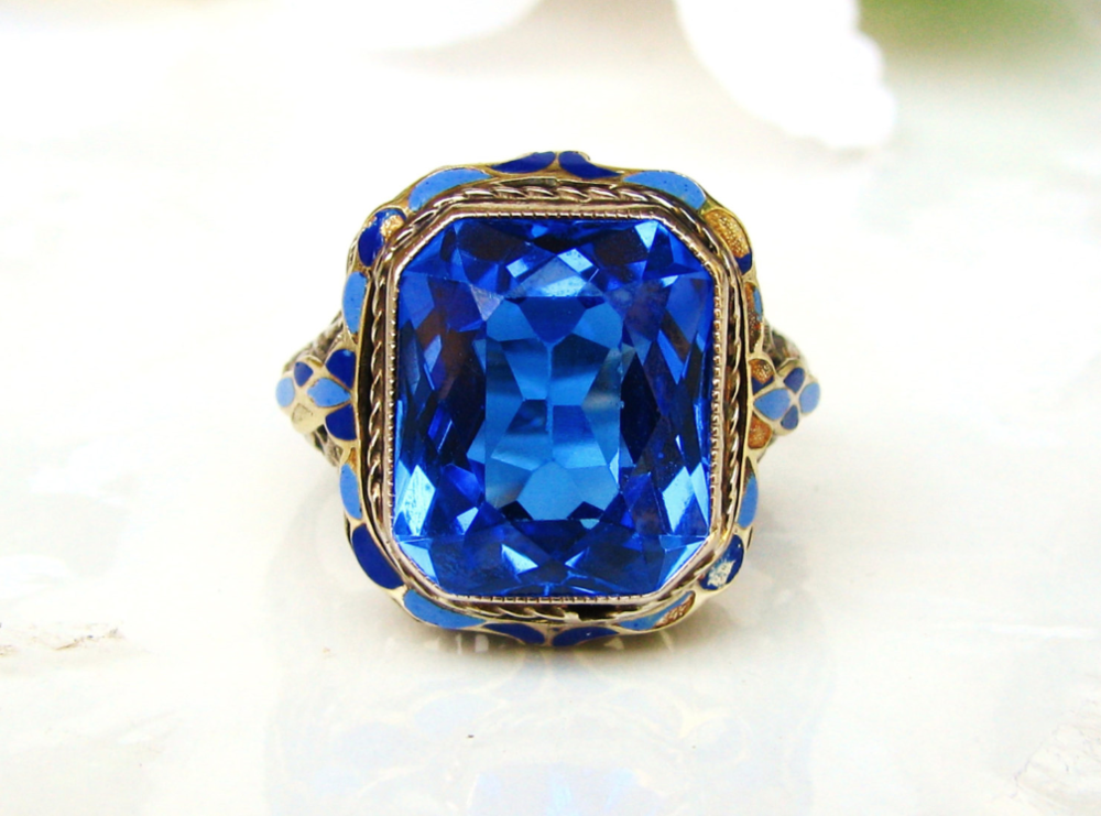 From LadyRoseVintageJewel on Etsy - $875 - from the 1920s, Blue Spinel and Enamel