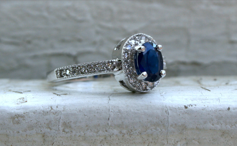 From GoldAdore on Etsy - $745 - Vintage, Sapphire and Diamonds This is actually similar to my own engagement ring.  Except mine is all twisty on the side.