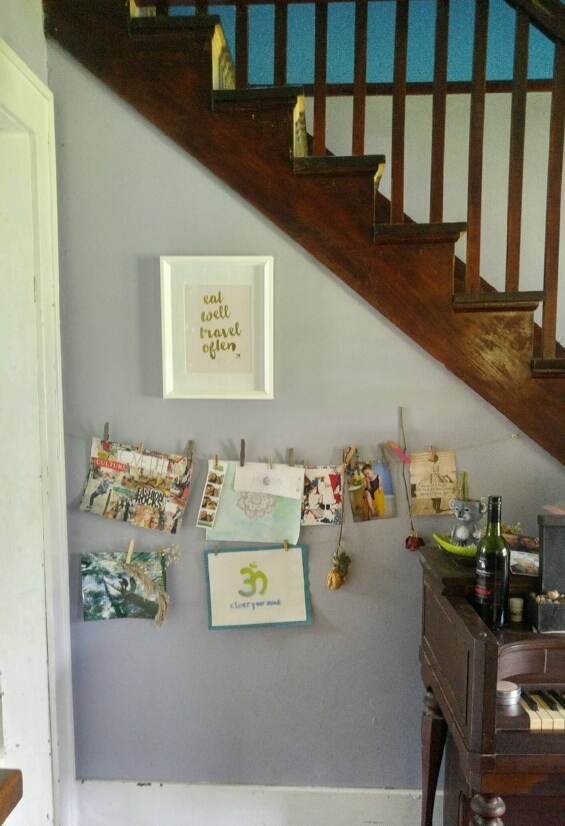 "To the left of the piano, and right outside the kitchen entrance is a space for art and photos.  The ""Eat Well, Travel Often"" print was a gift from her daughters for Mother's Day.  This describes Brooke's goals very well.  She has been a vegetarian most of her life and is committed to eating wholesome and ethically produced food.  And, in the past few years, she has been enjoying some travel abroad....and enjoying some yummy food while there."